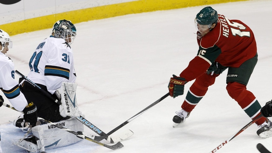 San Jose Sharks goalie Antti Niemi (31), of Finland, deflects a shot off his pads by Minnesota Wild left wing Dany Heatley (15) during the first period of an NHL hockey game in St. Paul, Minn., Sunday, Dec. 8, 2013. (AP Photo/Ann Heisenfelt)
