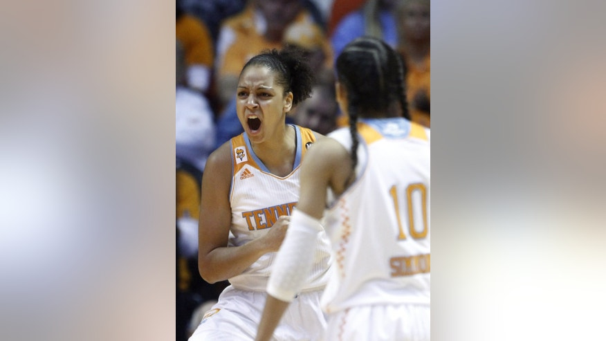 Tennessee forward Cierra Burdick (11) reacts to being fouled in the first half of an NCAA college basketball game against Texas on Sunday, Dec. 8, 2013, in Knoxville, Tenn. (AP Photo/Wade Payne)