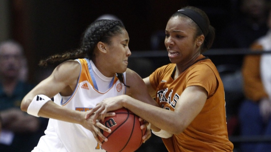 Tennessee guard Meighan Simmons, left, get tangled by Texas guard Brianna Taylor (20) in the first half of an NCAA college basketball game on Sunday, Dec. 8, 2013, in Knoxville, Tenn. (AP Photo/Wade Payne)