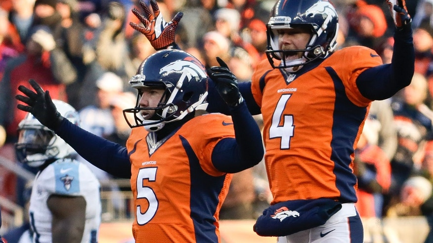 Denver Broncos kicker Matt Prater, left, celebrates a 64-yard field goal with Britton Colquitt during the first half of an NFL football game against the Tennessee Titans on Sunday, Dec. 8, 2013, in Denver. (AP Photo/Jack Dempsey)