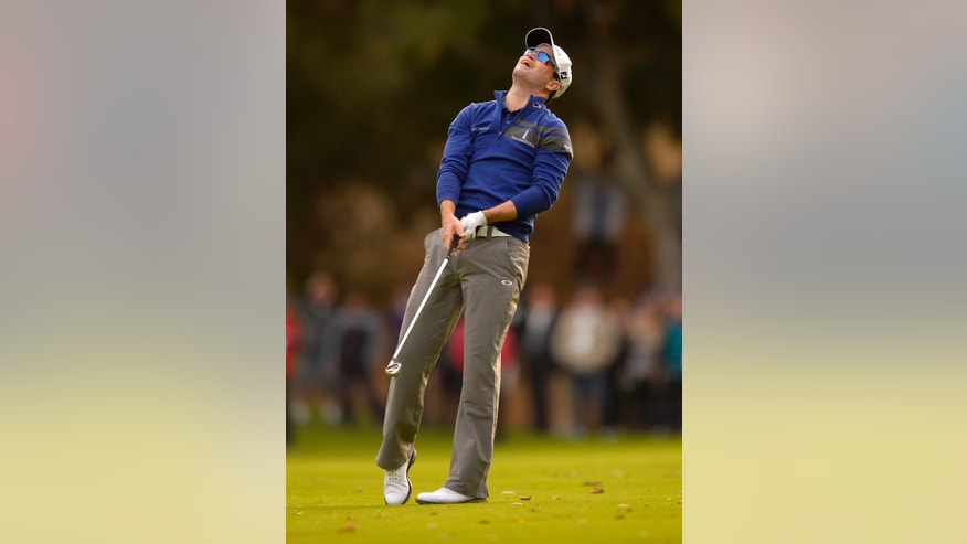 Zach Johnson reacts after hitting into a lake on the 18th hole during the final round of the Northwestern Mutual World Challenge golf tournament at Sherwood Country Club, Sunday, Dec. 8, 2013, in Thousand Oaks, Calif. (AP Photo/Mark J. Terrill)