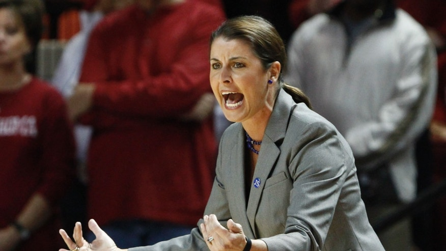Duke head coach Joanne P. McCallie yells to her team as they play against Oklahoma in the first half of an NCAA women's college basketball game in Norman, Okla., Sunday, Dec. 8, 2013. Duke won 94-85. (AP Photo/Alonzo Adams)