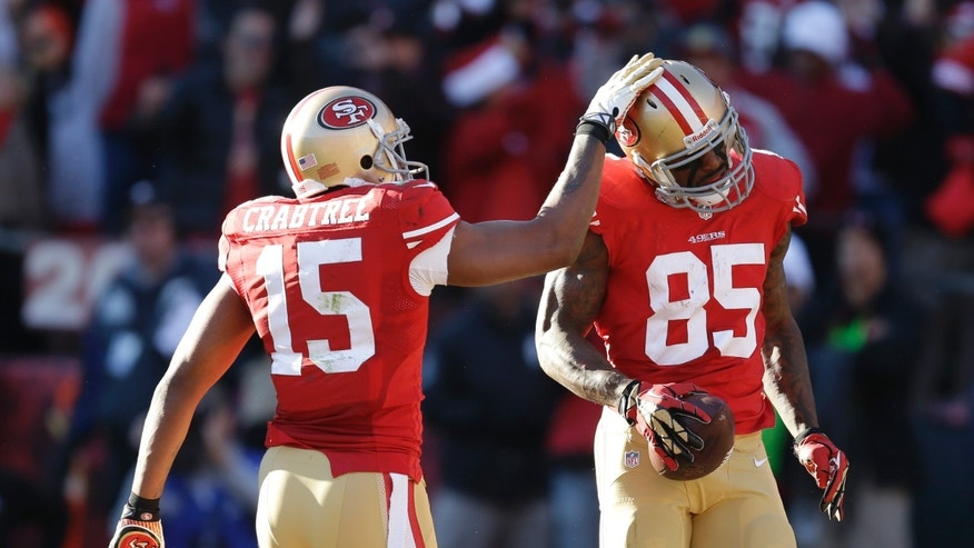 San Francisco 49ers tight end Vernon Davis (85) is greeted by 49ers' wide receiver Michael Crabtree (15) after Davis scored a touchdown against the Seattle Seahawks in the first half of an NFL football game, Sunday, Dec. 8, 2013, in San Francisco. (AP Photo/Ben Margot)
