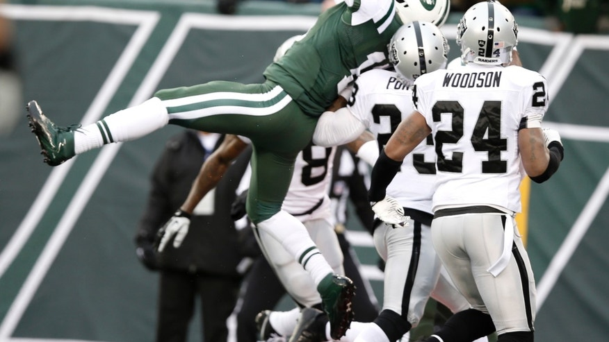 New York Jets wide receiver Jeremy Kerley, left, makes a touchdown catch on a pass from Geno Smith during the first half of an NFL football game against the Oakland Raiders, Sunday, Dec. 8, 2013, in East Rutherford, N.J. (AP Photo/Kathy Willens)