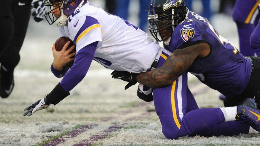Minnesota Vikings quarterback Matt Cassel is tackled by Baltimore Ravens outside linebacker Terrell Suggs in the second half of an NFL football game, Sunday, Dec. 8, 2013, in Baltimore. (AP Photo/Nick Wass)