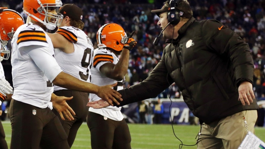 Cleveland Browns head coach Rob Chudzinski, right, congratulates  quarterback Jason Campbell after his touchdown pass to Jordan Cameron in the fourth quarter of an NFL football game against the New England Patriots, Sunday, Dec. 8, 2013, in Foxborough, Mass. (AP Photo/Steven Senne)