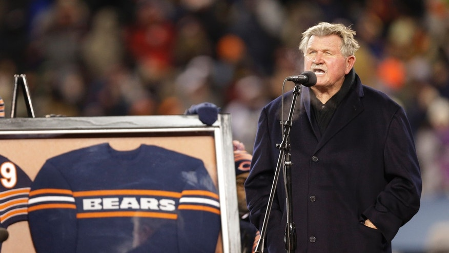 Former Chicago Bears player and coach Mike Ditka speaks to the fans at Soldier Field as his No. 89 is retired during a halftime ceremony of an NFL football game between the Bears and Dallas Cowboys, Monday, Dec. 9, 2013, in Chicago. (AP Photo/Nam Y. Huh)