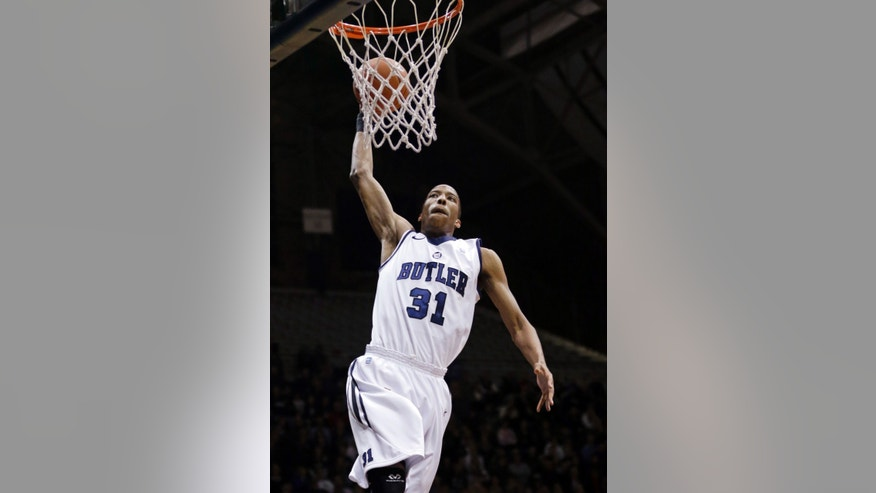Butler forward Kameron Woods gets a slam dunk against Manchester in the first half of an NCAA college basketball game in Indianapolis, Monday, Dec. 9, 2013. (AP Photo/Michael Conroy)