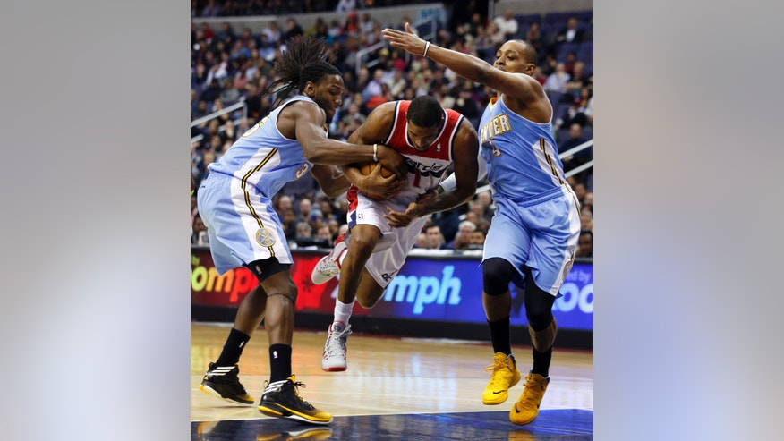 Denver Nuggets forward Kenneth Faried (35) and guard Randy Foye (4) combine on Washington Wizards forward Trevor Ariza (1) in the second half of an NBA basketball game Monday, Dec. 9, 2013 in Washington. The Nuggets won 75-74. (AP Photo/Alex Brandon)