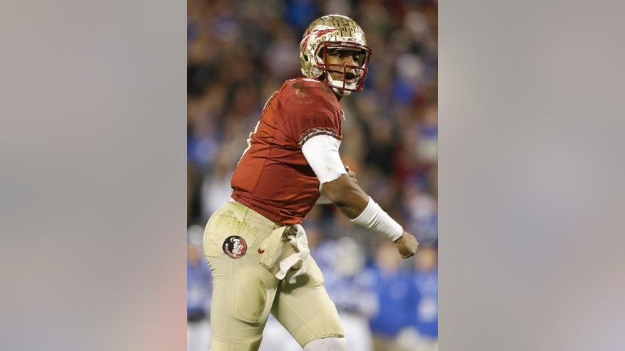 Florida State quarterback Jameis Winston reacts after a teammate's touchdown against Duke in the first half of the Atlantic Coast Conference Championship NCAA football game in Charlotte, N.C., Saturday, Dec. 7, 2013. (AP Photo/Bob Leverone)