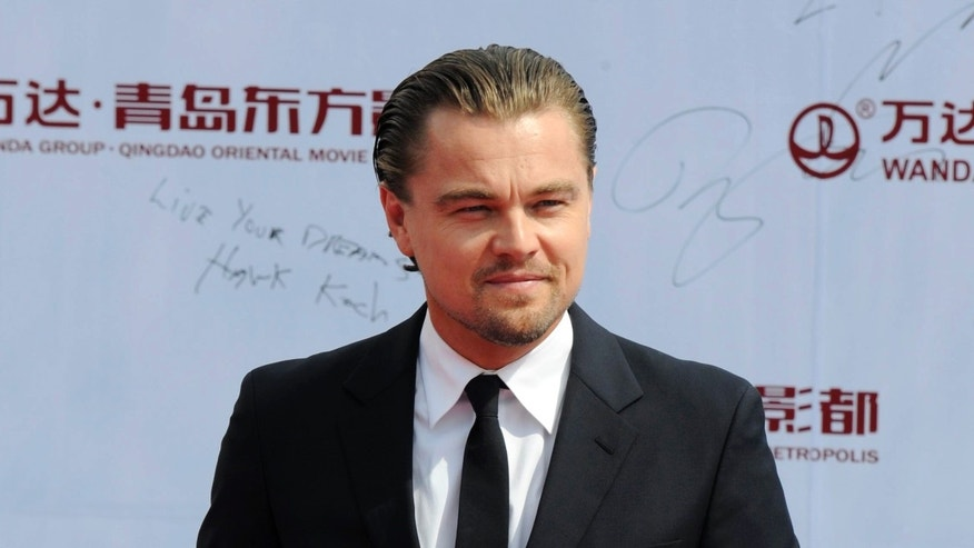 "FILE - This Sept. 22, 2013 file photo shows actor Leonardo DiCaprio at the launching ceremony of Qingdao Oriental Movie ""Metropolis"" in Qingdao in east China's Shandong province. Venturi Automobiles announced Monday, Dec. 9, 2013, a joint venture with award-winning actor and environmental activist Leonardo DiCaprio to enter a team in the new FIA Formula E Championship - the world's first fully-electric race series beginning in September 2014. (AP Photo, File)"