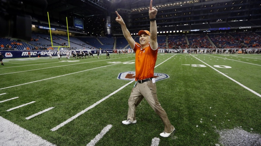 Bowling Green head coach Dave Clawson points to the crowd in the closing seconds of an NCAA college football game against Northern Illinois at the Mid-American Conference championship in Detroit, Friday, Dec. 6, 2013. Bowling Green won 47-27. (AP Photo/Carlos Osorio)