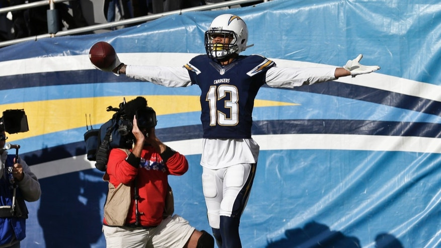 San Diego Chargers wide receiver Keenan Allen celebrates after his four yard touchdown pass reception against the New York Giants during the first half of an NFL football game Sunday, Dec. 8, 2013, in San Diego. (AP Photo/Gregory Bull)