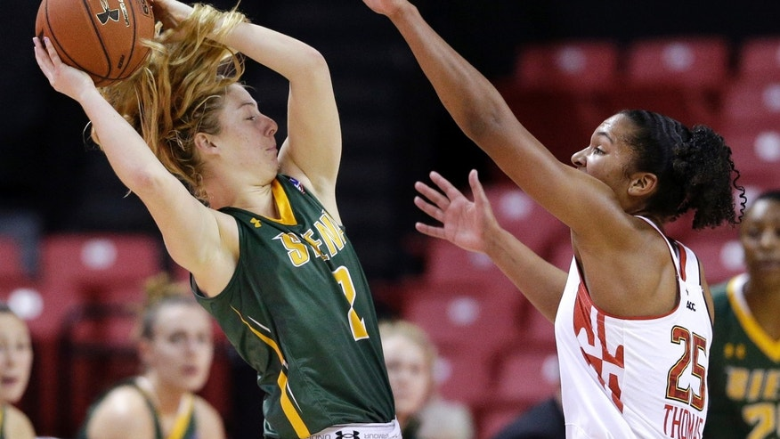 Siena's Ida Krogh, left, of Denmark, protects the ball from Maryland forward Alyssa Thomas in the second half of an NCAA college basketball game in College Park, Md., Monday, Dec. 9, 2013. (AP Photo/Patrick Semansky)