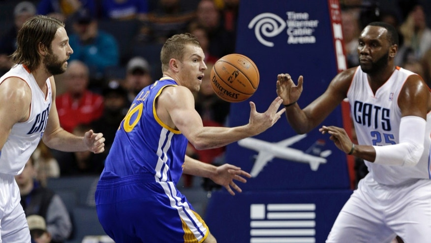 Golden State Warriors' David Lee, center, loses the ball as Charlotte Bobcats' Josh McRoberts, left, and Al Jefferson, right, defend during the first half of an NBA basketball game in Charlotte, N.C., Monday, Dec. 9, 2013. (AP Photo/Chuck Burton)