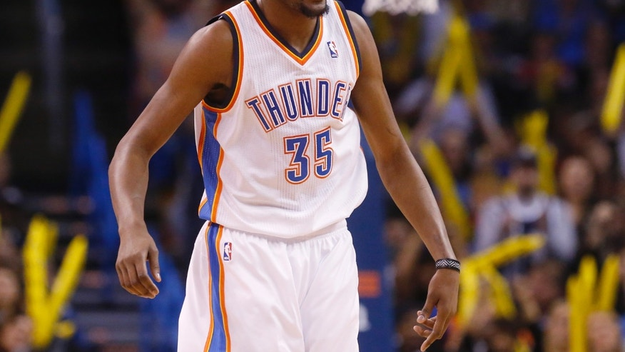 Oklahoma City Thunder forward Kevin Durant (35) celebrates following a basket by teammate Kendrick Perkins in the second quarter of an NBA basketball game against the Indiana Pacers in Oklahoma City, Sunday, Dec. 8, 2013. (AP Photo/Sue Ogrocki)