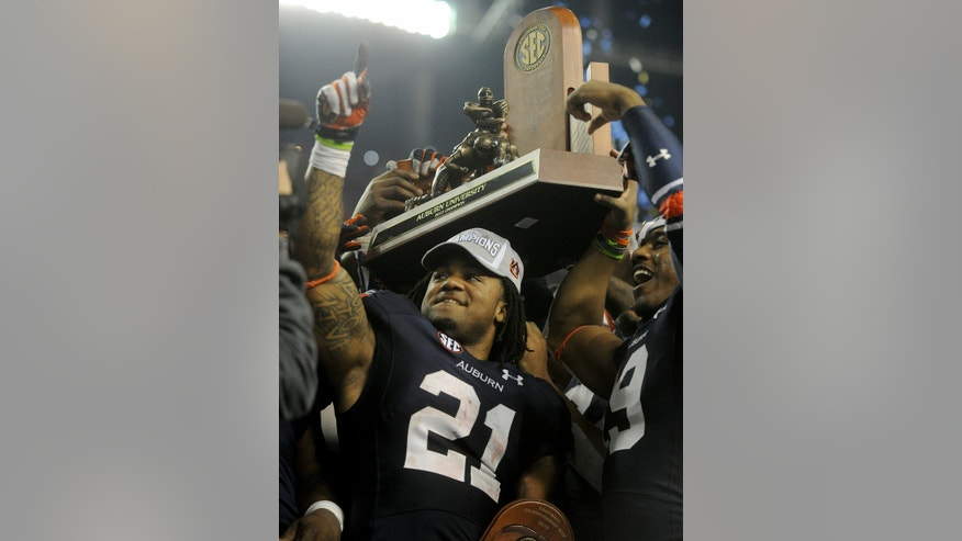 Auburn running back Tre Mason (21) celebrates the 59-42 victory over Missouri after the SEC Championship Saturday, Dec. 7, 2013, at the Georgia Dome in Atlanta, Ga. (AP Photo/AL.com, Julie Bennett)
