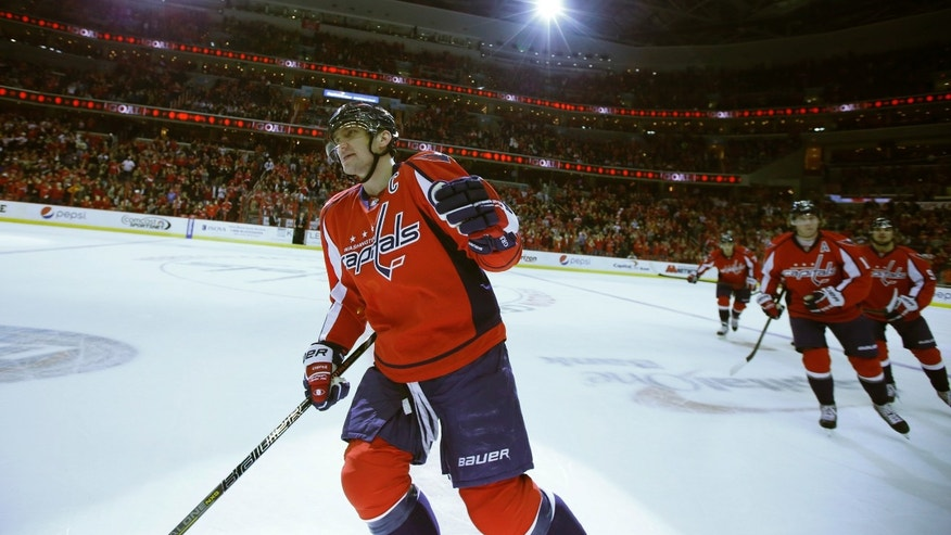 Washington Capitals right wing Alex Ovechkin, of Russia, celebrates after his goal in the first period of an NHL hockey game against the Tampa Bay Lightning, Tuesday, Dec. 10, 2013, in Washington. (AP Photo/Alex Brandon)
