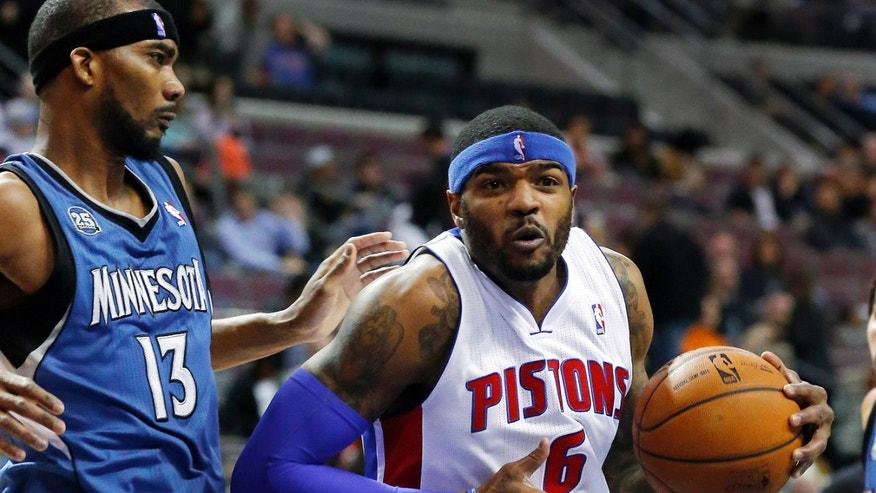 Detroit Pistons small forward Josh Smith (6) drives on Minnesota Timberwolves small forward Corey Brewer (13) in the first half of an NBA basketball game in Auburn Hills, Mich., Tuesday, Dec. 10, 2013. (AP Photo/Paul Sancya)