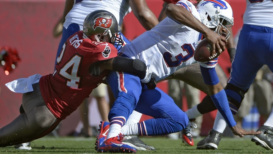 Tampa Bay Buccaneers cornerback Darrelle Revis (24) sacks Buffalo Bills quarterback EJ Manuel (3) during the second quarter of an NFL football game on Sunday, Dec. 8, 2013, in Tampa, Fla. (AP Photo/Phelan M. Ebenhack)