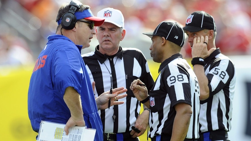 Buffalo Bills head coach Doug Marrone, left, talks to officials, from right, side judge Jimmy DeBell (58), head linesman Greg Bradley (98) and referee Bill Vinovich  during the second quarter of an NFL football game against the Tampa Bay Buccaneers Sunday, Dec. 8, 2013, in Tampa, Fla. (AP Photo/Brian Blanco)