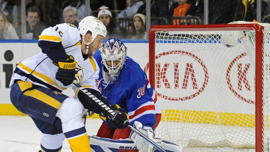 Nashville Predators' Rich Clune, left, scores a goal past New York Rangers goaltender Henrik Lundqvist, of Sweden, during the first period of an NHL hockey game Tuesday, Dec. 10, 2013, in New York. (AP Photo/Bill Kostroun)