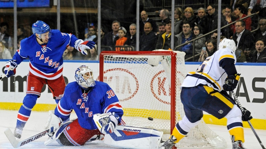 Nashville Predators' Rich Clune, right, scores a goal past New York Rangers goaltender Henrik Lundqvist (30), of Sweden, during the first period of an NHL hockey game Tuesday, Dec. 10, 2013, in New York. (AP Photo/Bill Kostroun)