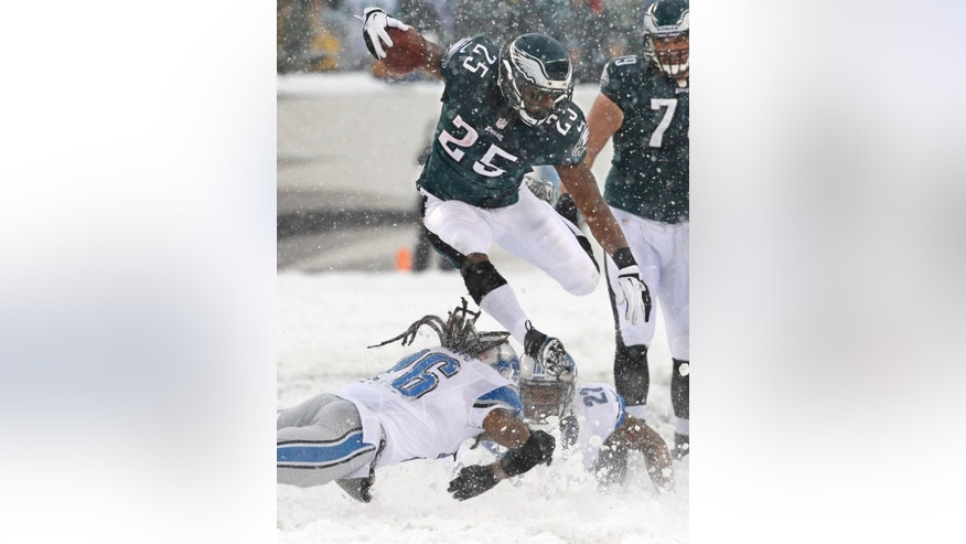 Philadelphia Eagles' LeSean McCoy (25) leaps over two would-be Detroit Lions tacklers as he runs to score his first of two touchdowns of an NFL football game on Sunday, Dec. 8, 2013, in Philadelphia. (AP Photo/Philadelphia Inquirer, Ron Cortes) PHILADELPHIA OUT; NEWARK, N.J. OUT; TV OUT; MAGAZINES OUT