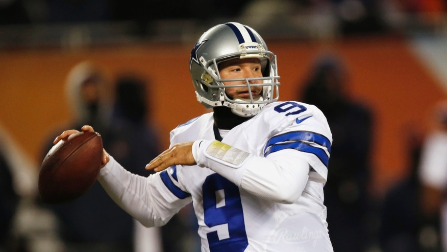 Dallas Cowboys quarterback Tony Romo (9) throws a pass against the Chicago Bears during the first half of an NFL football game, Monday, Dec. 9, 2013, in Chicago. (AP Photo/Charles Rex Arbogast)