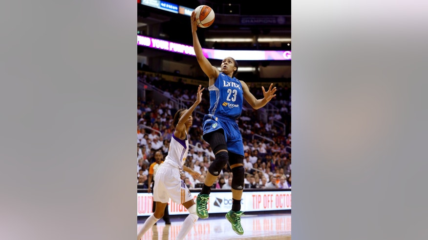 FILE - In this Sept. 29, 2013 file photo, Minnesota Lynx's Maya Moore (23) scores as she gets past Phoenix Mercury's DeWanna Bonner, left, during the second half in a WNBA Western Conference Finals basketball game in Phoenix. Moore co-stars in Pepsi's Uncle Drew ad campaign that features Cleveland Cavaliers star Kyrie Irving. (AP Photo/Ross D. Franklin, File)