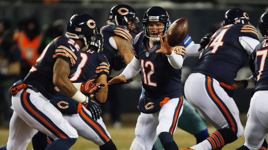 Chicago Bears quarterback Josh McCown (12) pitches the ball to Chicago Bears running back Matt Forte (22) during the first half of an NFL football game against the Dallas Cowboys, Monday, Dec. 9, 2013, in Chicago. (AP Photo/Charles Rex Arbogast)