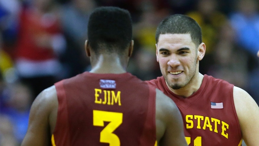 Iowa State's Georges Niang, right, reacts with teammate Melvin Ejim after Ejim scored during overtime of an NCAA college basketball game against Northern Iowa, Saturday, Dec. 7, 2013, in Des Moines, Iowa. Niang and Ejim each scored 22 points as Iowa State won 91-82. (AP Photo/Charlie Neibergall)