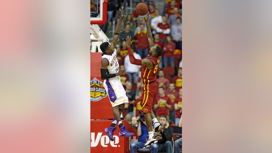 Iowa State guard DeAndre Kane, right, shoots over Northern Iowa guard Wes Washpun during the second half of an NCAA college basketball game, Saturday, Dec. 7, 2013, in Des Moines, Iowa. Iowa State won 91-82 in overtime. (AP Photo/Charlie Neibergall)