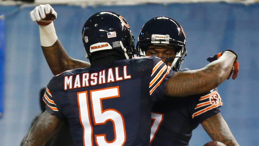 Chicago Bears wide receiver Alshon Jeffery (17) is congratulated by wide receiver Brandon Marshall (15) for his touchdown reception against the Dallas Cowboys during the first half of an NFL football game, Monday, Dec. 9, 2013, in Chicago. (AP Photo/Charles Rex Arbogast)