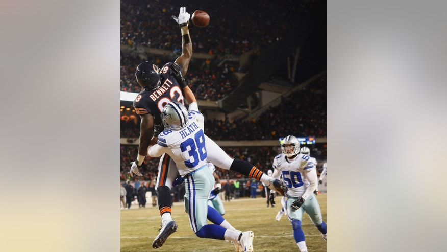 Dallas Cowboys safety Jeff Heath (38) breaks up a pass intended for Chicago Bears tight end Martellus Bennett (83) during the first half of an NFL football game, Monday, Dec. 9, 2013, in Chicago. (AP Photo/Charles Rex Arbogast)