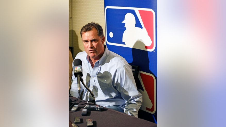 John Farrell, manager of the Boston Red Sox answers questions at a news conference during the MLB winter meetings in Lake Buena Vista, Fla., Monday, Dec. 9, 2013. (AP Photo/John Raoux)