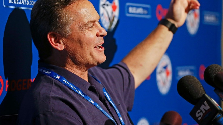 John Gibbons, manager of the Toronto Blue Jays, speaks with reporters during a news conference during MLB winter meetings in Lake Buena Vista, Fla., Monday, Dec. 9, 2013. (AP Photo/John Raoux)