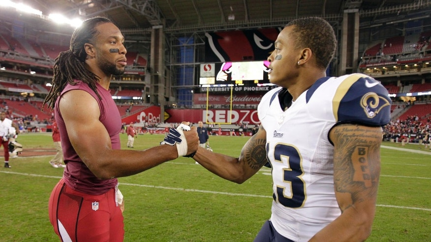 Arizona Cardinals wide receiver Larry Fitzgerald, left, greets St. Louis Rams wide receiver Chris Givens after an NFL football game, Sunday, Dec. 8, 2013, in Glendale, Ariz. The Cardinals won 30-10. (AP Photo/Rick Scuteri)