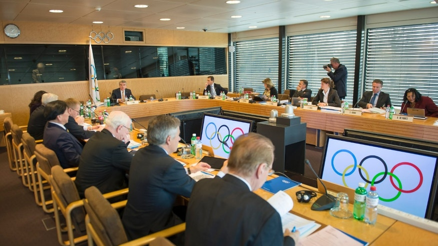 Dec. 10, 2013: International Olympic Committee, IOC, President German Thomas Bach, center back,  attends the opening of the executive board's meeting, at the IOC headquarters, in Lausanne, Switzerland.