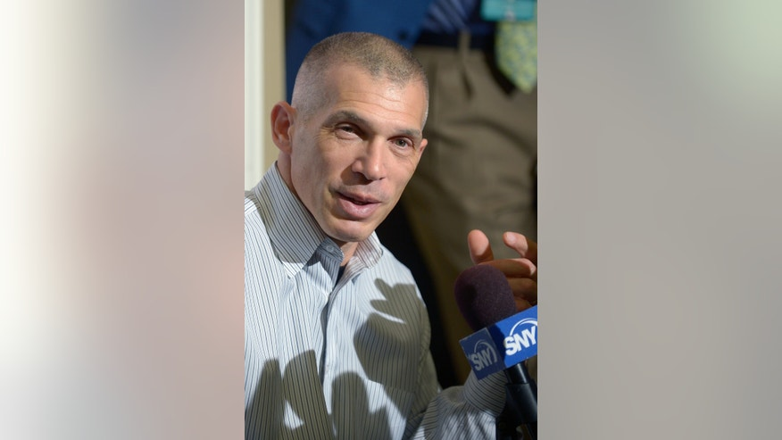 New York Yankees manager Joe Girardi answers a question during a media availability at baseball's winter meetings in Lake Buena Vista, Fla., Tuesday, Dec. 10, 2013. (AP Photo/Phelan M. Ebenhack)
