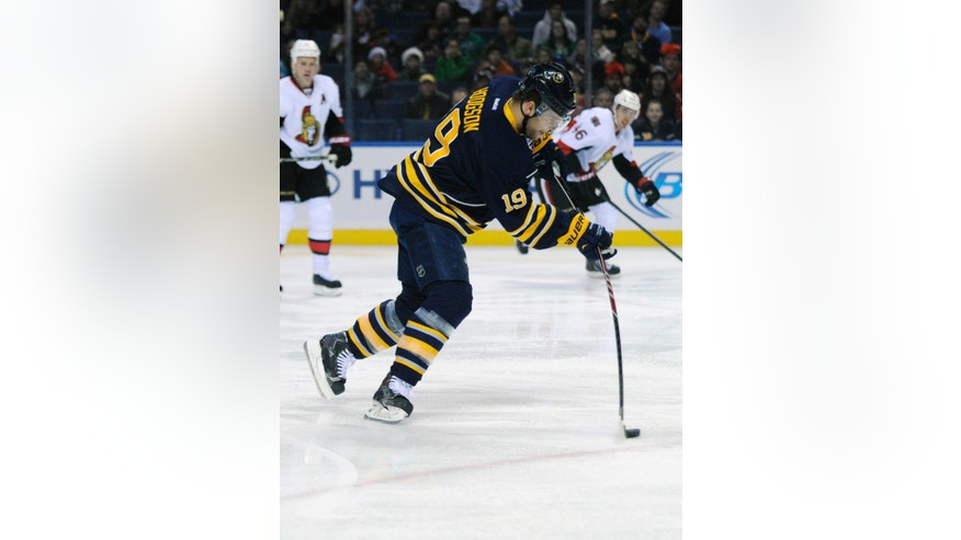 Buffalo Sabres center Cody Hodgson (19) fires a shot in the Ottawa Senators zone during the first period of an NHL hockey game in Buffalo, N.Y., Tuesday, Dec. 10, 2013. (AP Photo/Gary Wiepert)