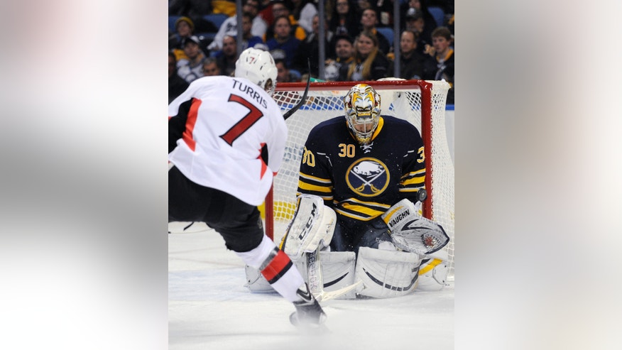 Ottawa Senators center Kyle Turris (7) hits the goal post with his shot as Buffalo Sabres goaltender Ryan Miller (30) reacts during the second period of an NHL hockey game in Buffalo, N.Y., Tuesday, Dec. 10, 2013. (AP Photo/Gary Wiepert)