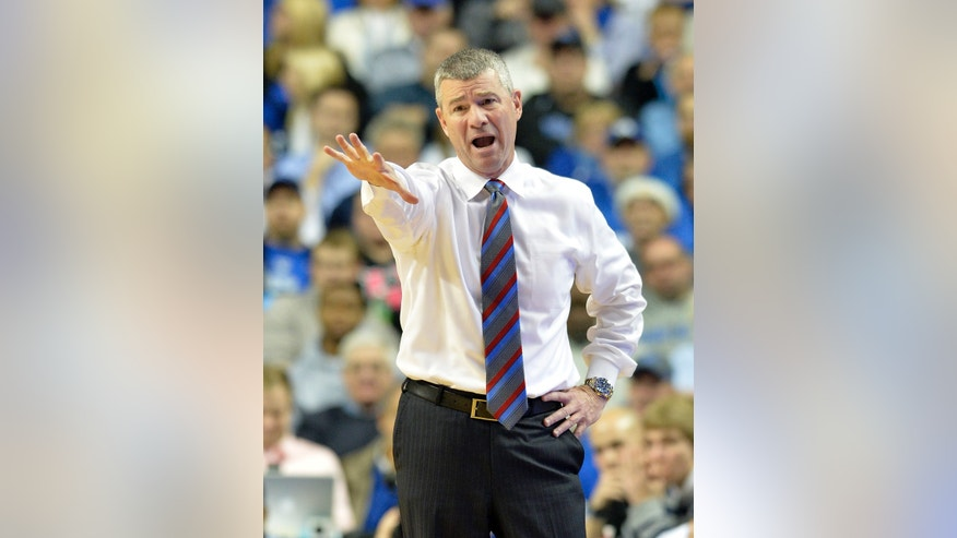 Boise State's head coach Leon Rice shouts instructions to his team during the second half of an NCAA college basketball game Tuesday Dec. 10, 2013, in Lexington, Ky. Kentucky defeated Boise State 70-55. (AP Photo/Timothy D. Easley)