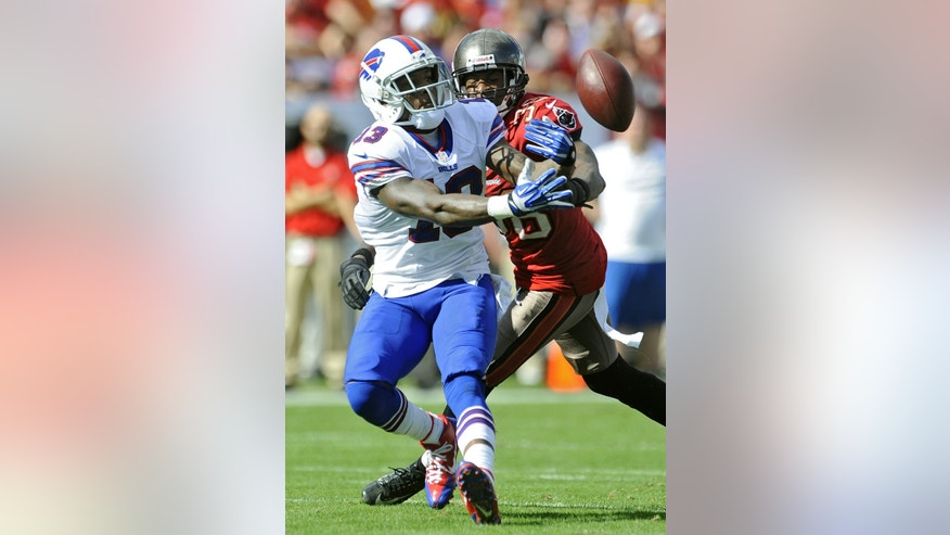 Buffalo Bills wide receiver Steve Johnson (13) tries to get a hand onto the ball as he is hit by Tampa Bay Buccaneers free safety Dashon Goldson (38) during the second quarter of an NFL football game on Sunday, Dec. 8, 2013, in Tampa, Fla. (AP Photo/Brian Blanco)