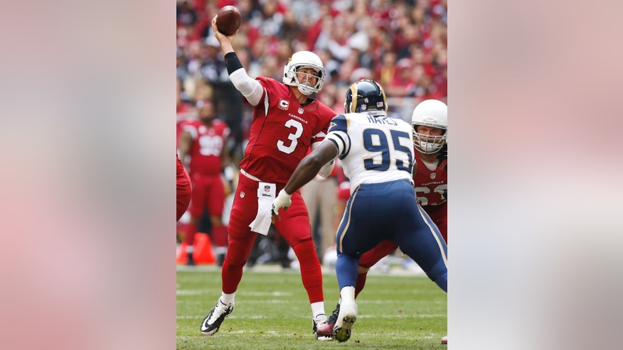 Arizona Cardinals quarterback Carson Palmer (3) throws under pressure from St. Louis Rams defensive end William Hayes (95) during the first half of an NFL football game, Sunday, Dec. 8, 2013, in Glendale, Ariz. (AP Photo/Ross D. Franklin)