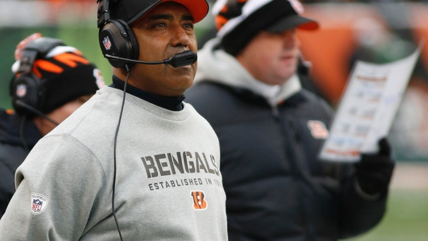 Cincinnati Bengals head coach Marvin Lewis watches from the sidelines in the first half of an NFL football game against the Indianapolis Colts, Sunday, Dec. 8, 2013, in Cincinnati. (AP Photo/David Kohl)
