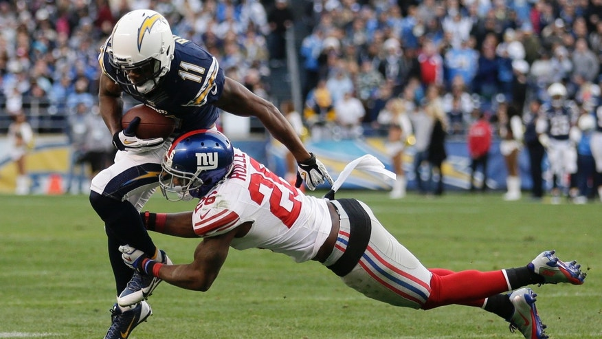 San Diego Chargers wide receiver Eddie Royal, left, gets past New York Giants strong safety Antrel Rolle, right, in the second half of an NFL football game on Sunday, Dec. 8, 2013, in San Diego. (AP Photo/Gregory Bull)