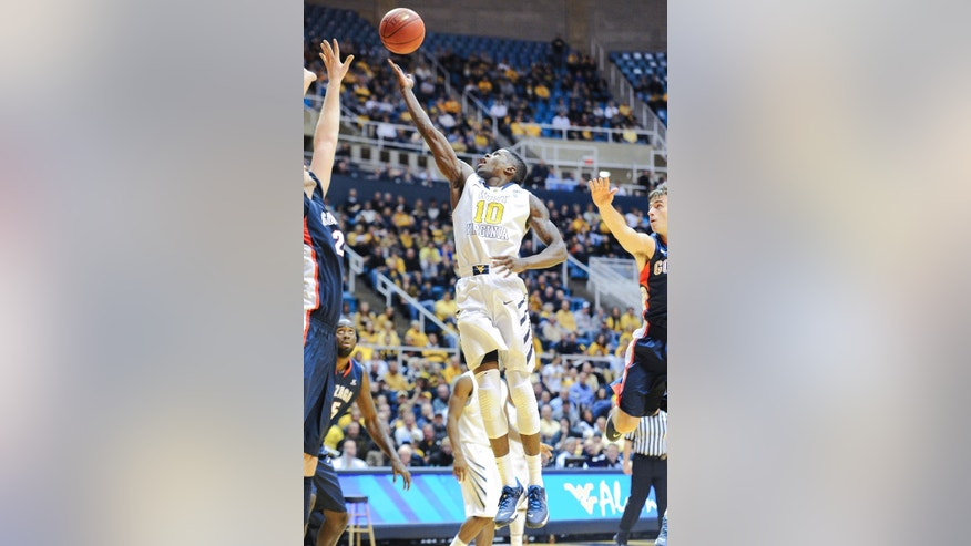 West Virginia's Eron Harris (10) drives to the basket during the second half of an NCAA college basketball game against Gonzaga, Tuesday, Dec. 10, 2013, in Morgantown, W.Va. Gonzaga won 80-76. (AP Photo/Andrew Ferguson)
