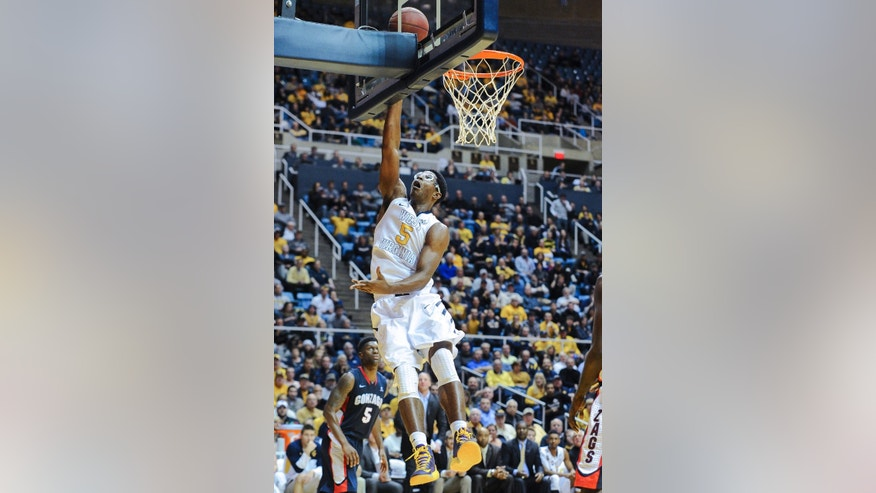 West Virginia's Devin Williams (5) lays in a basket during the second half of an NCAA college basketball game against Gonzaga, Tuesday, Dec. 10, 2013, in Morgantown, W.Va. Gonzaga won 80-76. (AP Photo/Andrew Ferguson)