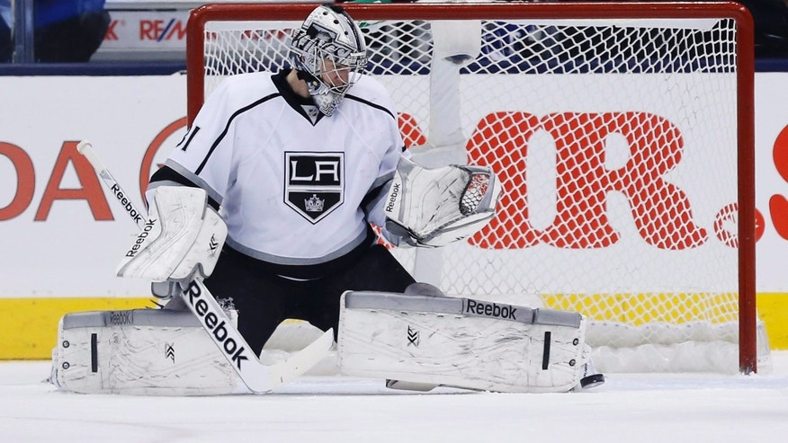 Los Angeles Kings goalie Martin Jones makes a save against the Toronto Maple Leafs during first period NHL hockey action in Toronto Wednesday,  Dec. 11, 2013. (AP Photo/The Canadian Press, Mark Blinch)